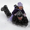 Gloucester: Megan Cilufo, 5, rides down a hill toward Parisi Field with her dad, Joe, at Stage Fort Park Saturday afternoon.  Mary Muckenhoupt/Gloucester Daily Times